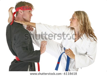 Martial arts man and woman fighting - stock photo