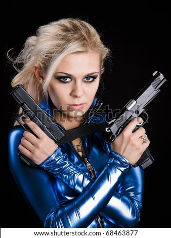martial young lady with two guns - stock photo