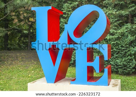 Martigny, Switzerland - AUGUST 29: copy of sculpture LOVE by american artist Robert Indiana on August 29, 2014 Martigny, Switzerland, original located in Center City, Philadelphia, Pennsylvania - stock photo