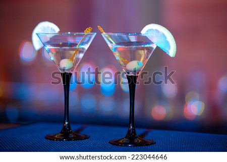 Martini. Alcohol drinks and cocktails on bar. colored light - stock photo
