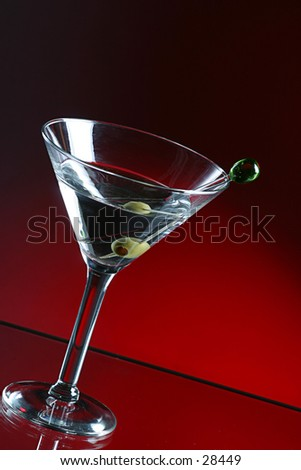 Martini  and olive in martini  glass. - stock photo