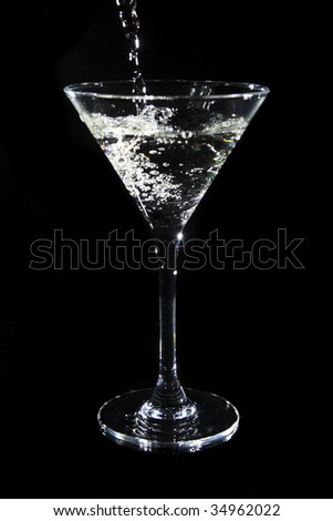 Martini being poured into a glass - stock photo