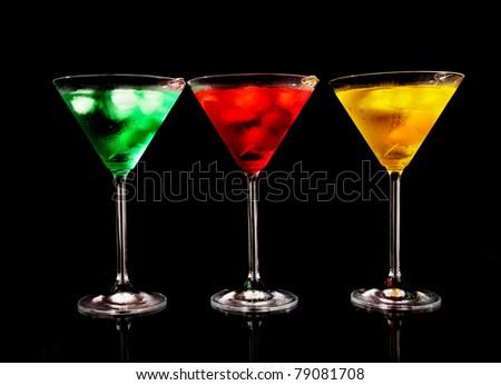 Martini drinks on black background - stock photo