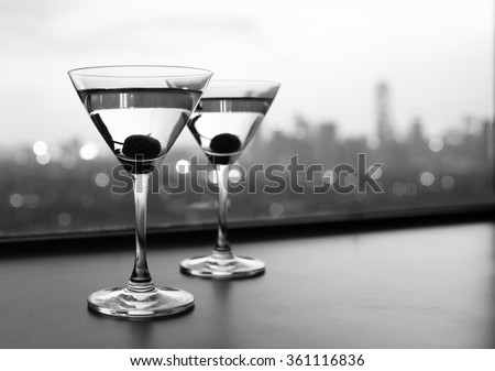 Martini glass against city background - stock photo