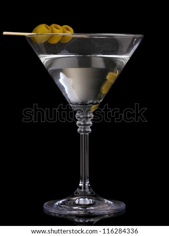 Martini glass and olives on grey background - stock photo
