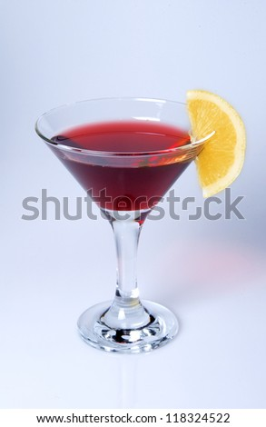 Martini glass close-up, decoration on the edge  with red wine and lemon - stock photo