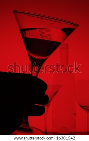 martini glass on red background - stock photo
