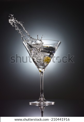 martini glass splash vodka cocktail - stock photo