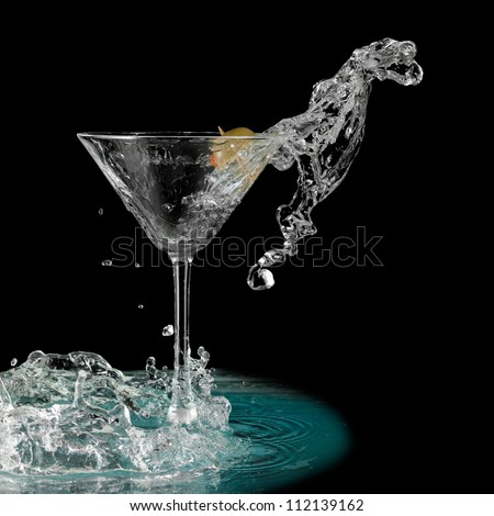 Martini glass with a olive splash like a dragon