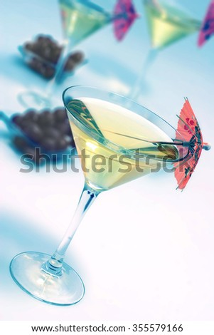 martini glass with black olives - stock photo