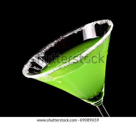 Martini glass with green coctail on black background - stock photo