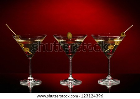 Martini glasses on dark background - stock photo