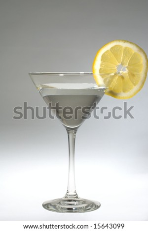 Martini with a lemon slice against white