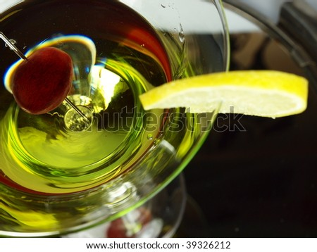 Martini with grape wine and citrus slice