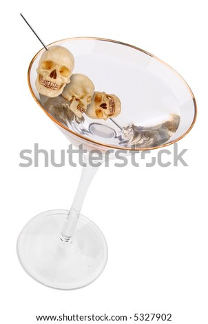Martini with human skull olives isolated on white background with clipping path - stock photo