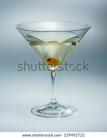 Martini with olive isolated. vermouth - stock photo
