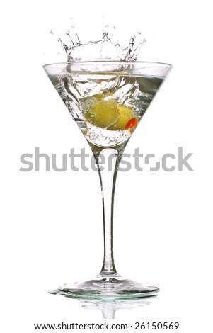 martini with olives and a splash - stock photo