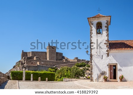 Marvao medieval Castle and Santa Maria Church, currently the municipal museum. Mavao, Portalegre District, Alto Alentejo, Portugal. Marvao was a candidate to World Heritage Site by UNESCO. - stock photo