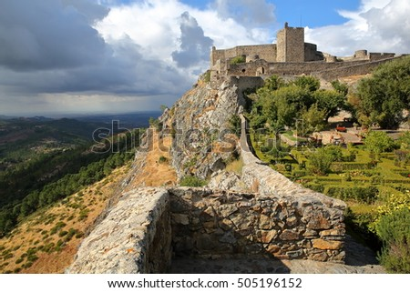MARVAO, PORTUGAL: The walls and the medieval castle with its exterior gardens under a stormy sky