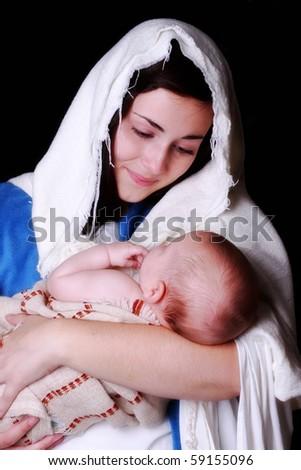 Mary holding  Baby Jesus - stock photo