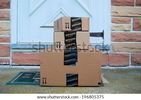 MARYLAND, USA - JUNE 3, 2014: Image of an Amazon packages. Amazon is an online company and is the largest retailer in the world.