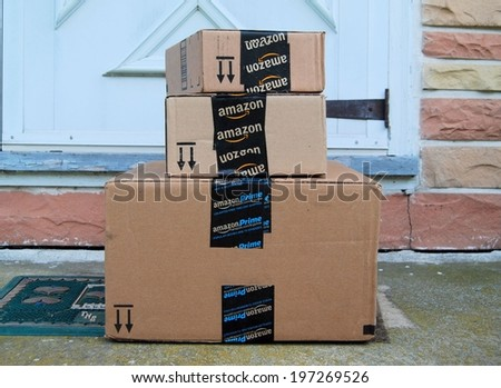 MARYLAND, USA - JUNE 3, 2014: Image of an Amazon packages. Amazon is an online company and is the largest retailer in the world.  - stock photo
