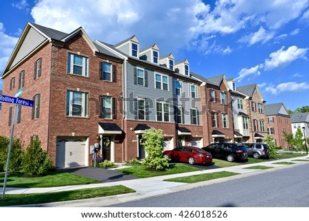 MARYLAND, USA - MAY 24, 2016: Beautiful luxury town homes in a planned Maryland community. New construction homes are very popular to first time home buyers.
