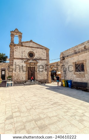 MARZAMEMI, ITALY -  AUGUST 19, 2014: tourists visit main square in Marzamemi, Italy. It is a small village just a few kilometres from Italy's southernmost point, in the deep south-east of Sicily.