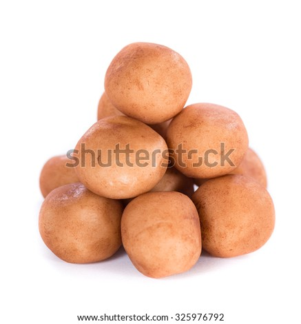 Marzipan Potatoes (German cuisine) isolated on white background - stock photo