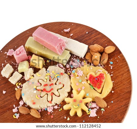 marzipan with almonds on wooden board - stock photo