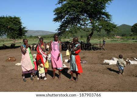 MASAI MARA, KENYA - JUNE 12, 2009: Group of african girls and children from Masai tribe in Kenya, show their traditional clothes on June 12, 2009 in a local village in Masai Mara