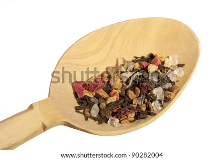 masala chai in wooden spoon on white - stock photo