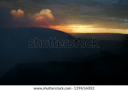 Masaya Volcano in Nicaragua. Taken at dusk and showing sulfurous smoke. - stock photo