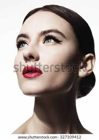 Mascara Applying. Long Lashes closeup. Mascara Brush. Eyelashes extensions. Makeup for Blue Eyes. Eye Make up Apply,red lips - stock photo