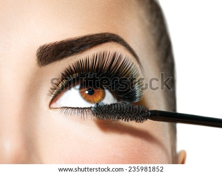 Mascara applying. Long Lashes closeup. Mascara Brush. Eyelashes extensions. Makeup for Brown Eyes. Eye Make up Apply  - stock photo
