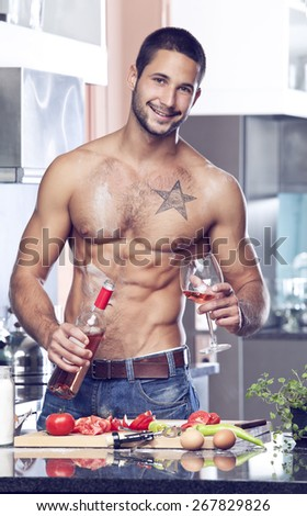 Mascular half-naked man in the kitchen  - stock photo