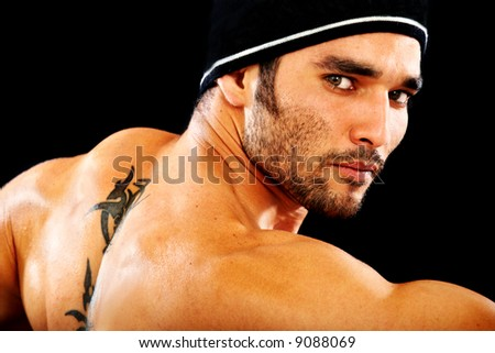 masculine man portrait staring at the camera isolated over a black background