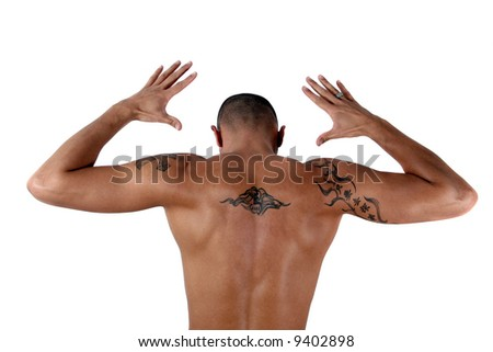 Masculine Young man showing his muscles and his tattooed back - isolated over white! - stock photo