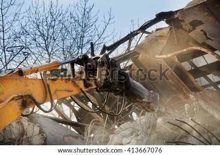Masha working at the demolition of an old industrial building. - stock photo