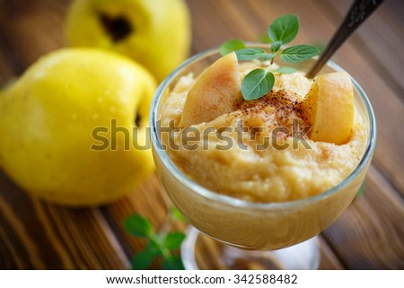 mashed cooked sweet quince with cinnamon and mint - stock photo
