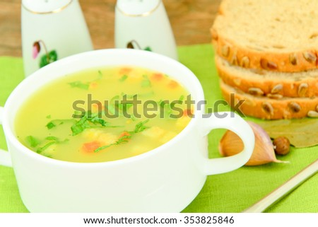 Mashed Pea Soup with Croutons. Studio Photo