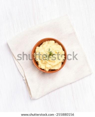 Mashed potato in ceramic bowl, top view - stock photo