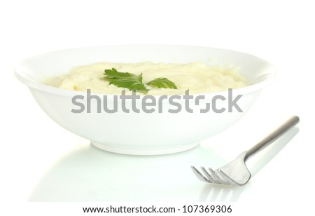 Mashed potato with parsley in the plate isolated on white
