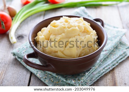 Mashed potatoes in rustic style - stock photo