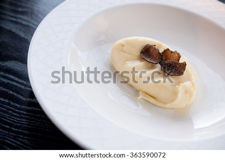 mashed potatoes with black truffles - stock photo