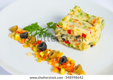 mashed potatoes with vegetables and herbs and olives chopped fine - stock photo