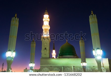 Masjid Al Nabawi or Nabawi Mosque (Mosque of the Prophet) at sunset in Medina (City of Lights), Saudi Arabia.Nabawi mosque is Islam's second holiest mosque after Haram Mosque (in Mecca, Saudi Arabia) - stock photo
