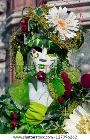 Mask Carnival of the most famous cities of Italy, Venice green mask