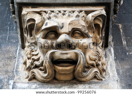 Mask. Detail of building in Aachen (Germany)