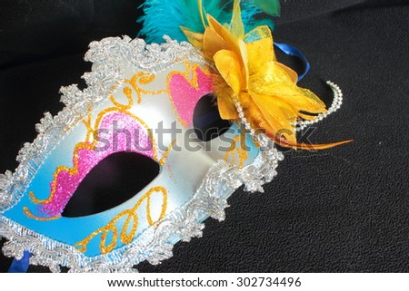 mask for masquerade with ornaments on a black background - stock photo